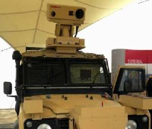 The Raytheon SOTERIA mounted on top of the Land Rover