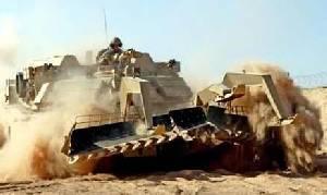 Marines use the Assault Breacher Vehicle to break mine fields