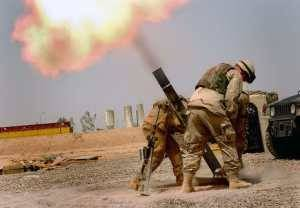 US soldiers in Iraq fire a 120mm mortar.