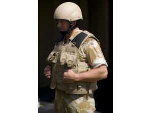 A Royal Marines Commando shows off the enhanced Mark 7 helmet and Osprey Assault body armour at DVD 2009