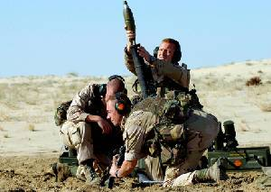 U.S. soldiers prepare to fire a mortar round