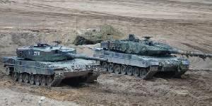 Рядом с польским танком Leopard 2A4 - немецкий A6
