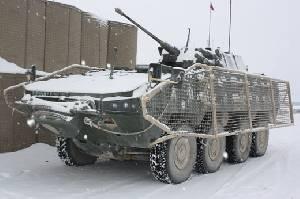 Rosomak M1 (Patria AMV) польской армии в Афганистане, оснащенная сетью для защиты от РПГ